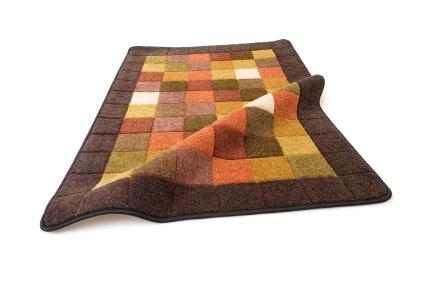 Kasthall tillverkar både vävda och handtuftade mattor